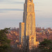 University of Pittsburgh Cathedral of Learning lit by the sunrise.