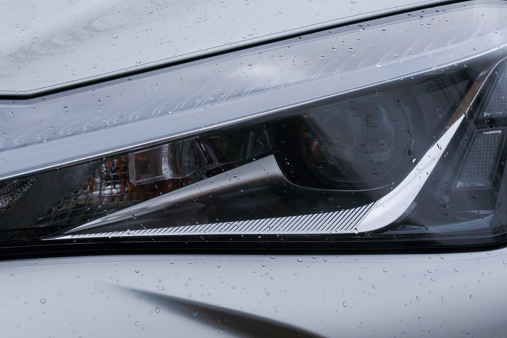 Rain beads up on one of the headlights of my 2020 Lexus UX 250h in February 2020