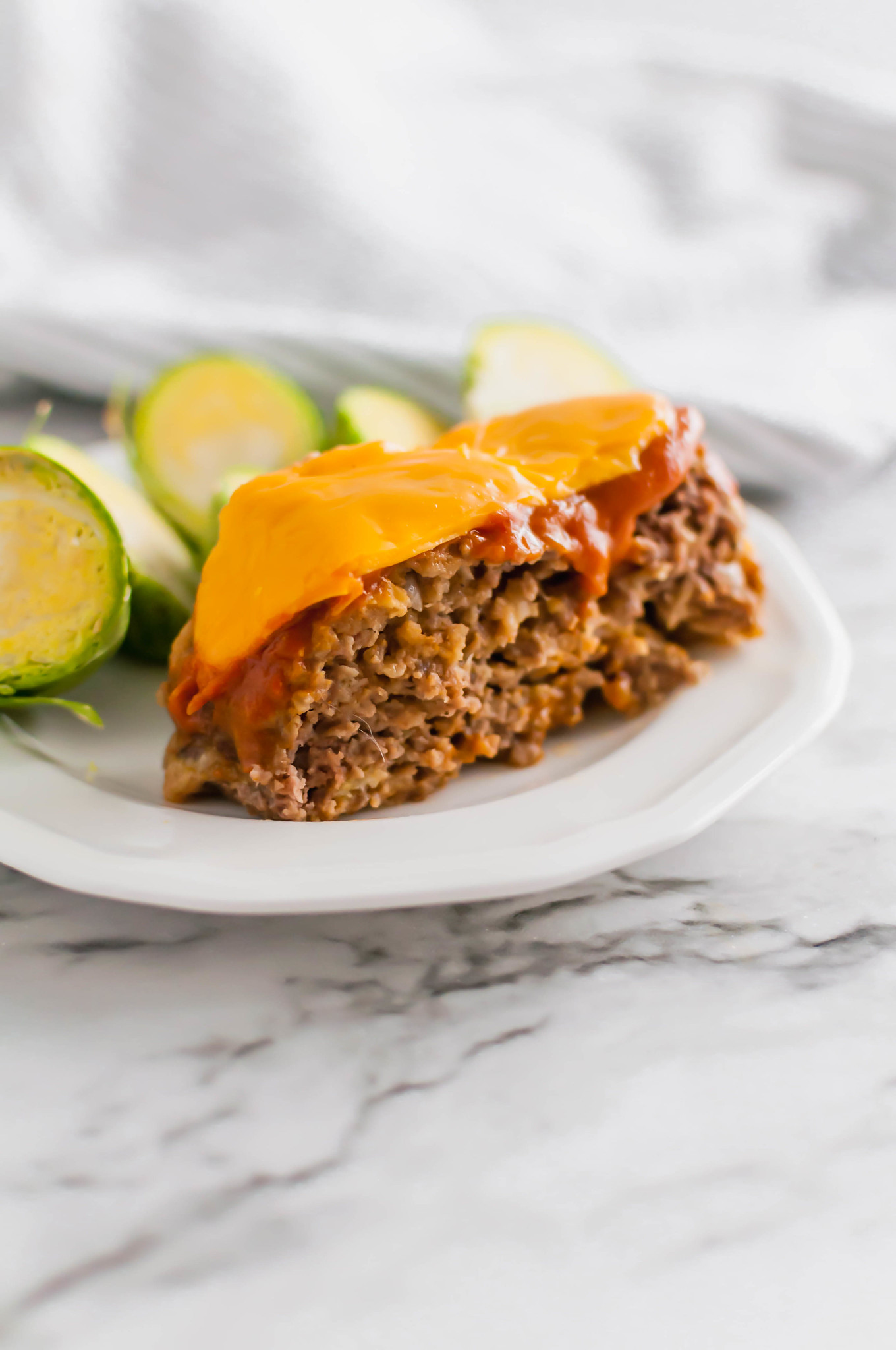 All the glorious flavors of a cheeseburger packed into an easy, weeknight friendly Cheeseburger Meatloaf. It's sure to become a family favorite.