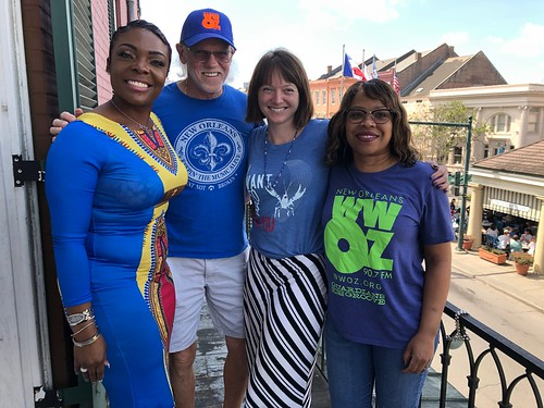 KaTrina Griffin, Cliff, Melanie Merz, and Patricia take a nice weather break from membership drive on our balcony overlooking the French Market - March 11, 2020. Photo by Carrie Booher.