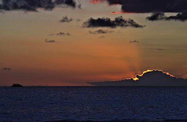 A distant ship smokes at the horizon ...