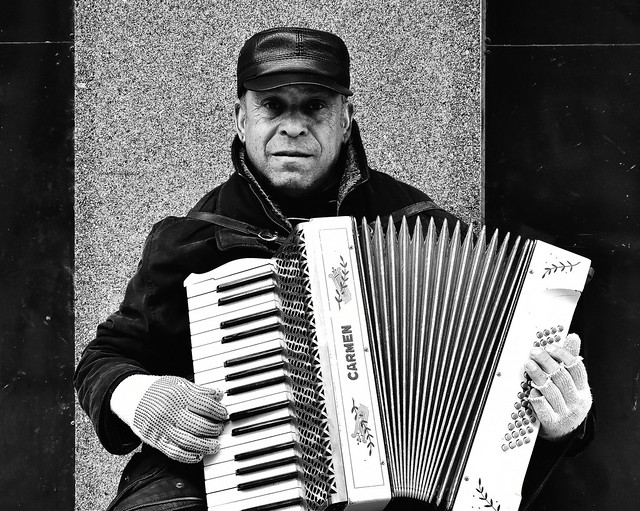 Squeezebox busker in Leeds city centre.