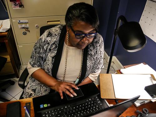 Volunteer coordinator Maryse Dejean hard at work - March 12, 2020. Photo by Katherine Johnson.