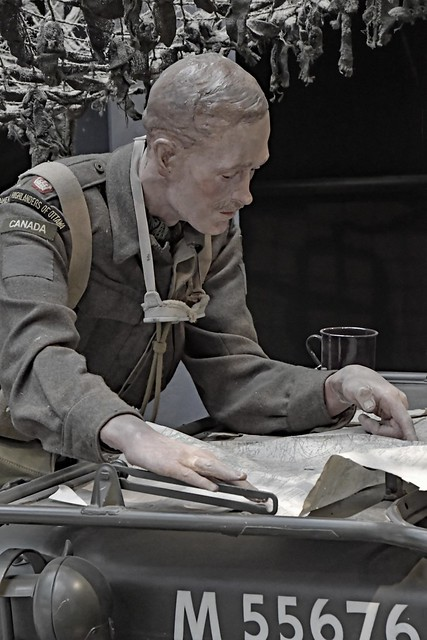 Soldier looking at his map