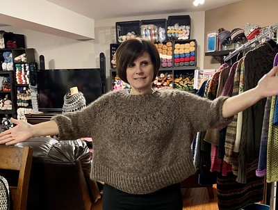 Karen in her Ranunculus knit using Diamond Luxury Collection Mulberry Linen held double with Drops Kid Silk.
