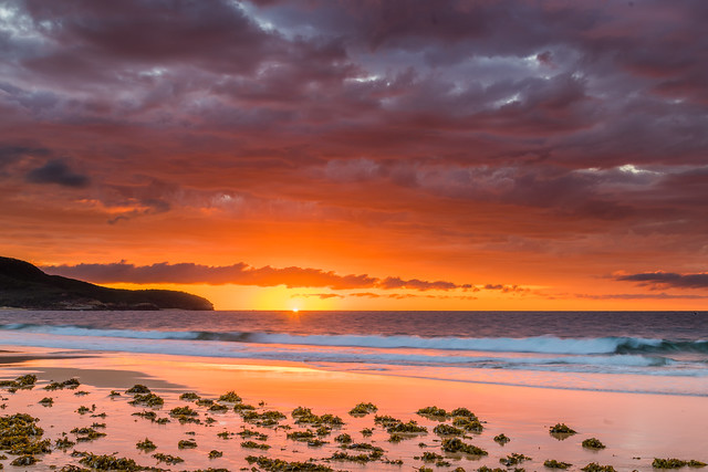 Clouds, rocks and the sea creating an atmospheric Sunrise Seascape