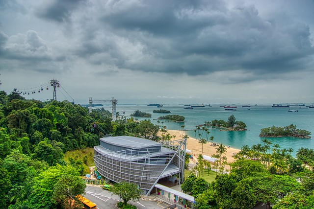 Sentosa island with cable car, beach islets and roadstead in Singapore