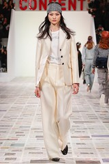 Dior's signature Bar jacket in pant-suit form serves as a perfect starting point for Maria Grazia Chiuri's feminist-themed fall 2020 Dior collection.