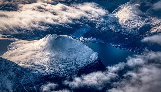 Detail view of beautiful mountain peak next toRauma Voll village seen from the Innfjorden, Norway 750a