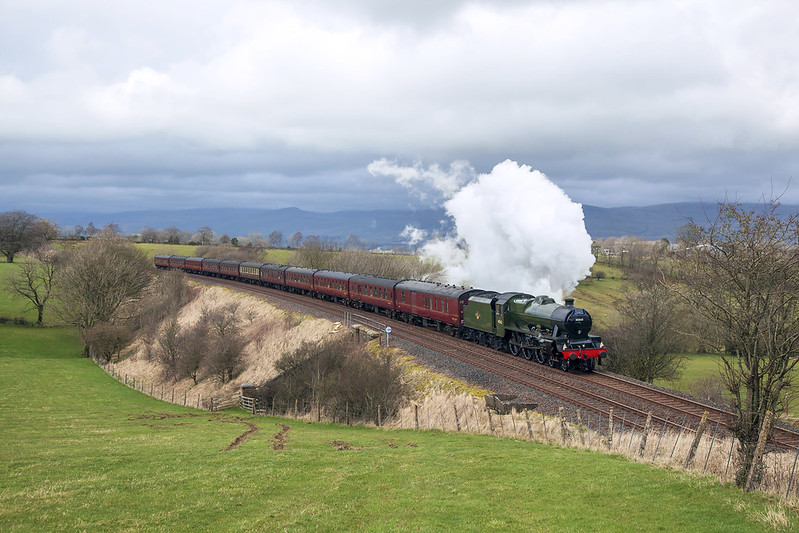 With the re-routed 'Cumbrian Coast Express' due to a landslide at Parton near Whitehaven, Jubilee No.45699 'Galatea' passes by Gallansay on the Settle Carlisle line. Recently repainted into BR green, she is masquerading as scrapped classmate No.45562 'Alberta'.