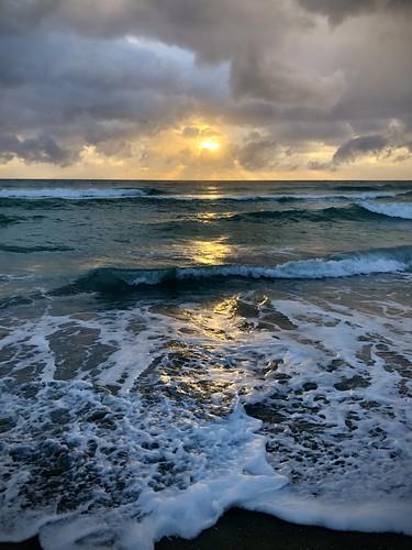 beach florida sunrise water reflection reflections ocean shore atlanticocean outside outdoor sand wave waves clouds sun morning daniabeach iphone iphonex cellphone