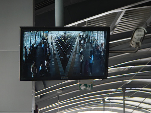 Rail TV screen showing both sides of the tracks in Bangkok's sky train, Thailand