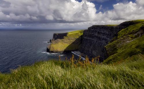 cliffsofmoher cliffs moher irelandcoast coastalireland countyclare ireland emeraldisle oceanview rockyshores beautifulireland seascapephotography fineartphotography openskies clouds sky blueskies greenhills landscapephotography