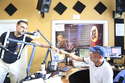 Your Cousin Dimitri and Al Colon fist bump on the air - March 12, 2020. Photo by Michele Goldfarb.