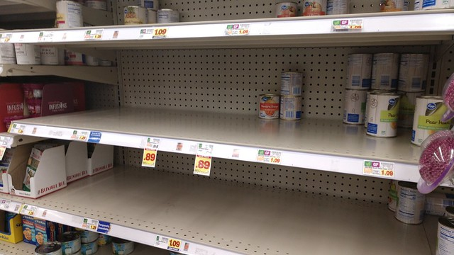 Empty canned fruit shelves