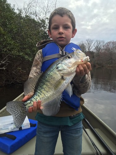 Photo of boy holding a crappie he caught