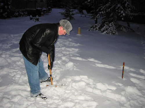 The Punisher takes his croquet shot in the Christmas snow, 2002 | by spudart