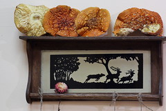 An old shelf made in 1941, with the deers and the Amanita caps