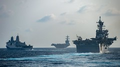 Ships from the Theodore Roosevelt Carrier Strike Group and the America Expeditionary Strike Group transit the South China Sea, March 15. (U.S. Navy/MC3 Nicholas Huynh)