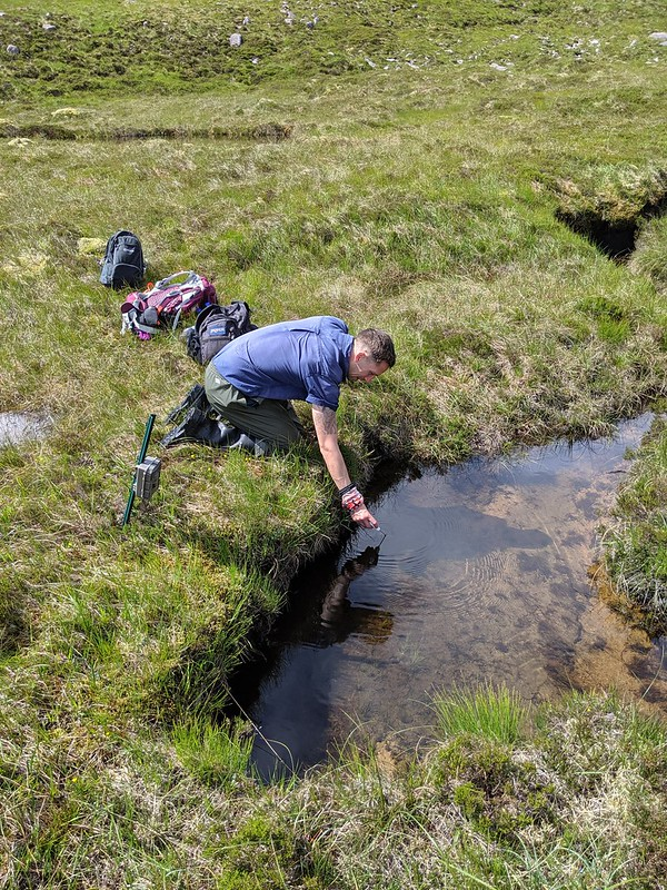 jdrake_Sam_taking_water_samples