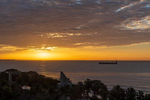 sunrise ship ocean trees clouds santo domingo