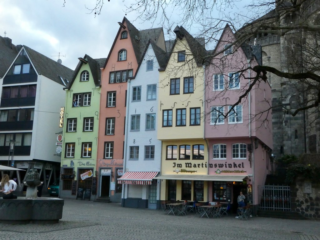 Colourful buildings line the riverside in Cologne