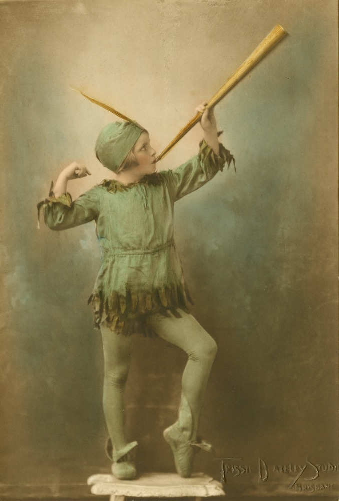 Young dancer striking a pose with a horn in a Peter Pan costume Brisbane Queensland 1931