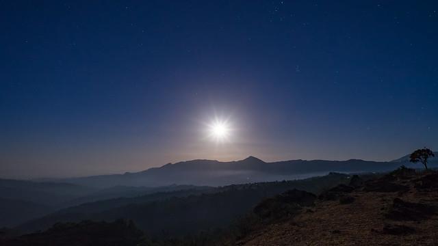 Timor. Puncak near Soe. Full moon over the mountains