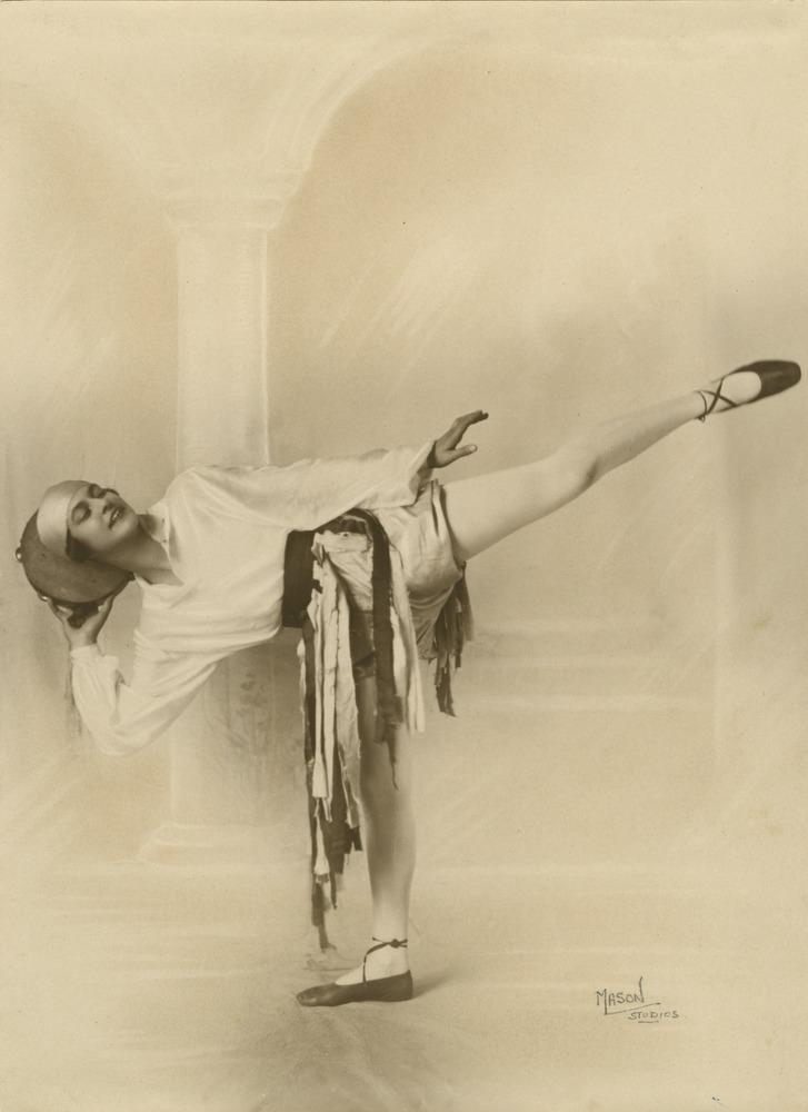 Ballet teacher Marjorie Hollinshed striking a pose with a tambourine Brisbane Queensland ca 1930