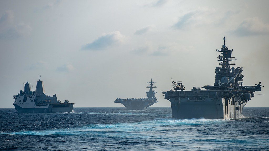 Ships from the Theodore Roosevelt Carrier Strike Group transit the South China Sea, March 15, 2020.