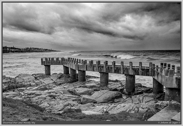 Deserted pier and moody sky (Explored)