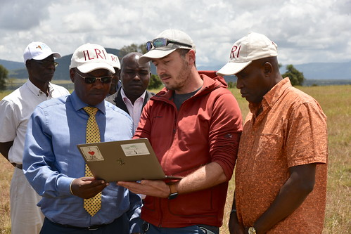 Lutz Merbold of ILRI's Mazigira Centre gives a demo to Harry Kimtai (left) and Ambassador Samuel Gitonga (right)
