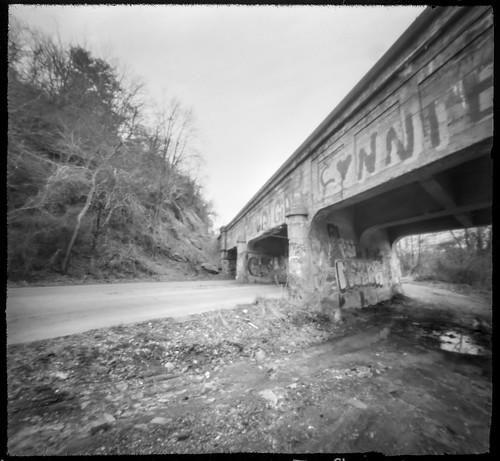 bridge railroadbridge urbandecay graffiti emmaroad asheville northcarolina 6x6 6x6pinholecamera pinhole ilforcpanf50 moerschecofilmdeveloper monochrome monochromatic blackandwhite mediumformat 120 120film film analog urbanlandscape