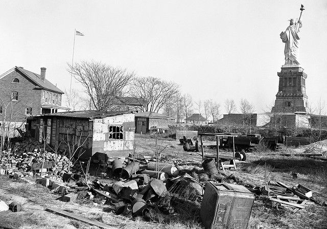 Abandoned buildings with shattered windows, rusting 50 gallon drums, wire spools and lots of rubbish were the only remnants of the Army's old Fort Wood behind the Statue of Liberty.  Bedloe's Island.  New York. 1948