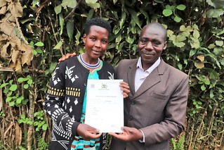 Acommunity member receives her certificate of customary ownership for her land