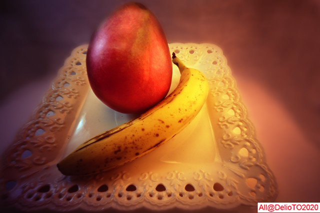 Banana and red apple