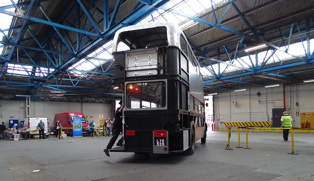 RT DOUBLE DECK LONDON TRANSPORT BUS UNDER RESTORATION AT A STREET BUS DEPOT OR GARAGE WITH PEOPLE IN AN EAST LONDON BOROUGH SUBURB OPEN DAY ENGLAND DSC01745