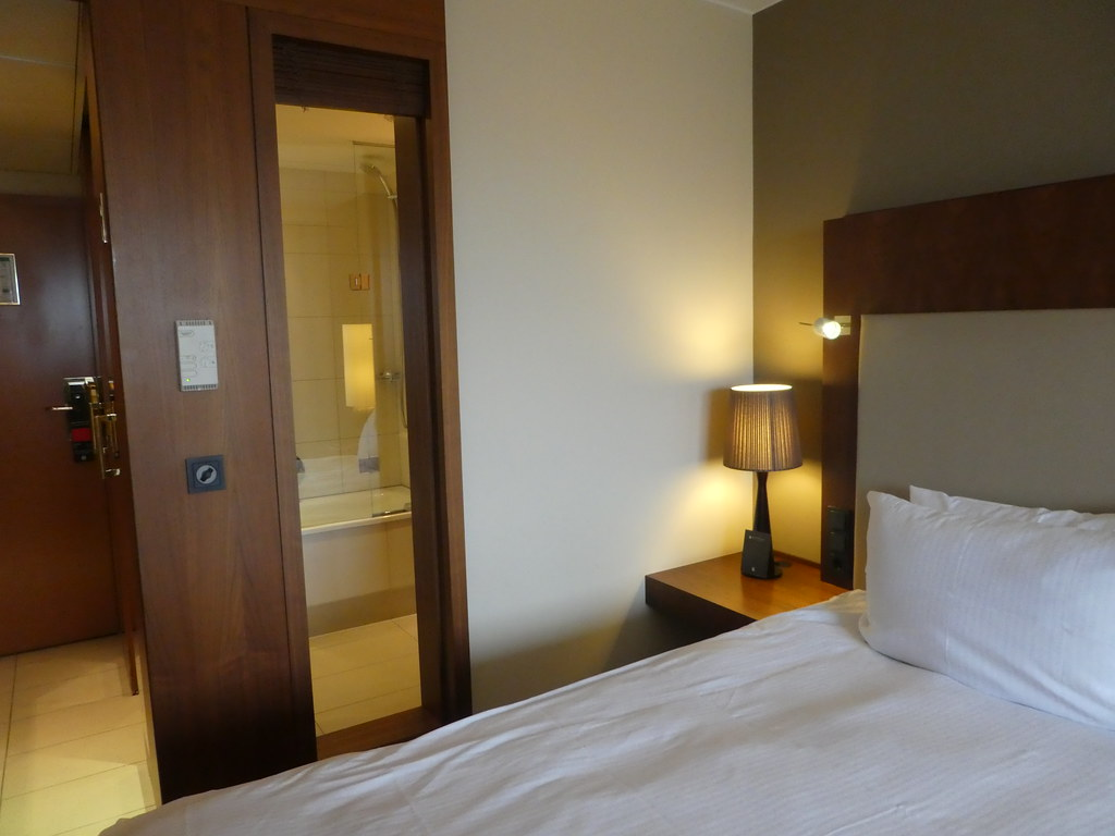 Our room at The Pullman Hotel, Cologne featuring a glass panel view of the bathroom