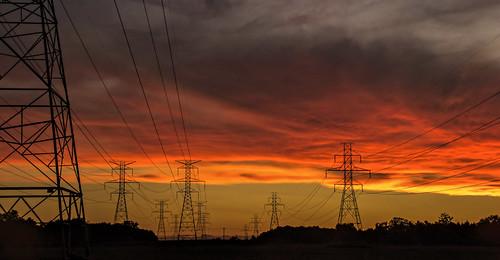 sunrise kevin power michigan ottawa july 2016 westmichigan powerfull ottawacounty jenison red sky orange yellow clouds early earlymorning morningsky canon7dmarkii turm strommasten pilone gittersteigen gittersteiger