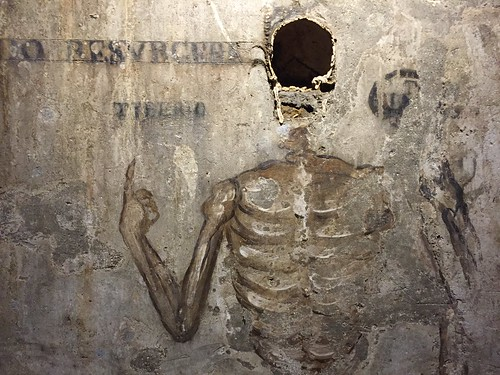 17th Century wall fresco with skull remains in The Catacombs of San Gaudioso in Naples, Italy.