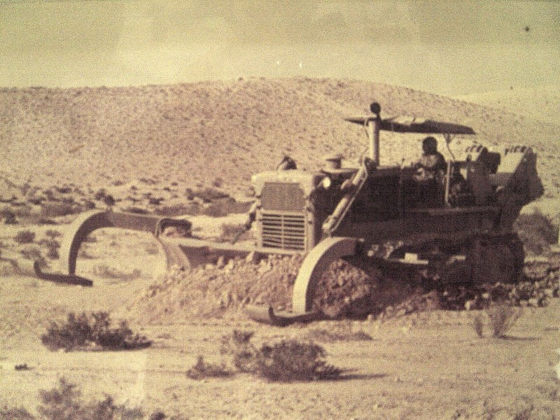 Tractor-with-mine-plow-f-1