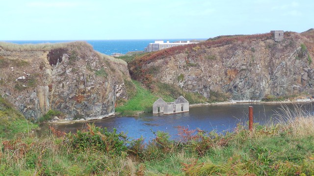 Water filled Quarry with abandoned building in Alderney