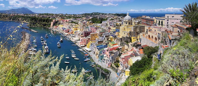 The Port of Corricella reflects typical Mediterranean pastel colours