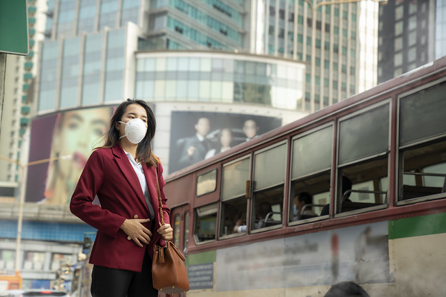 Asian girl use a protection mask for prevent PM 2.5 and corona viruus or covic 19