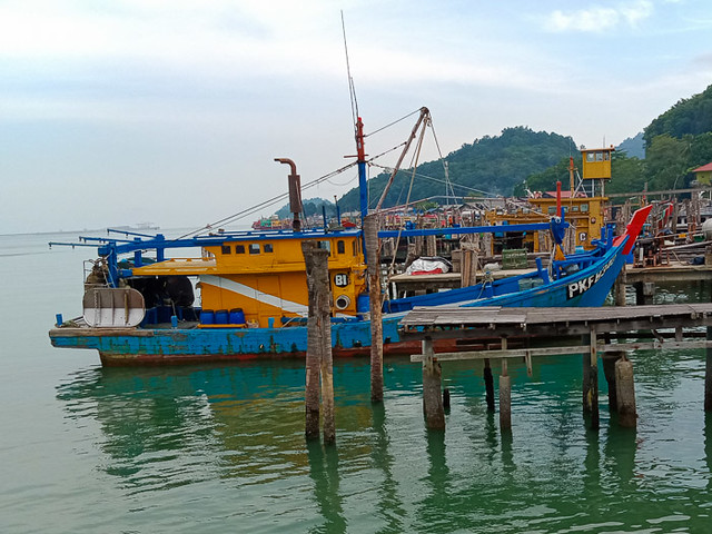 A trawler docked at Little Penang kampung