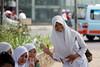 Veiled Indonesian muslim student girls with uniform in Batavia neighborood in Jakarta - Java, Indonesia by Alex_Saurel