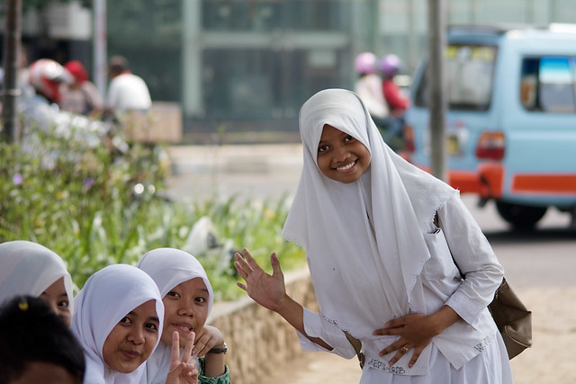 Veiled Indonesian muslim student girls with uniform in Batavia neighborood in Jakarta - Java, Indonesia