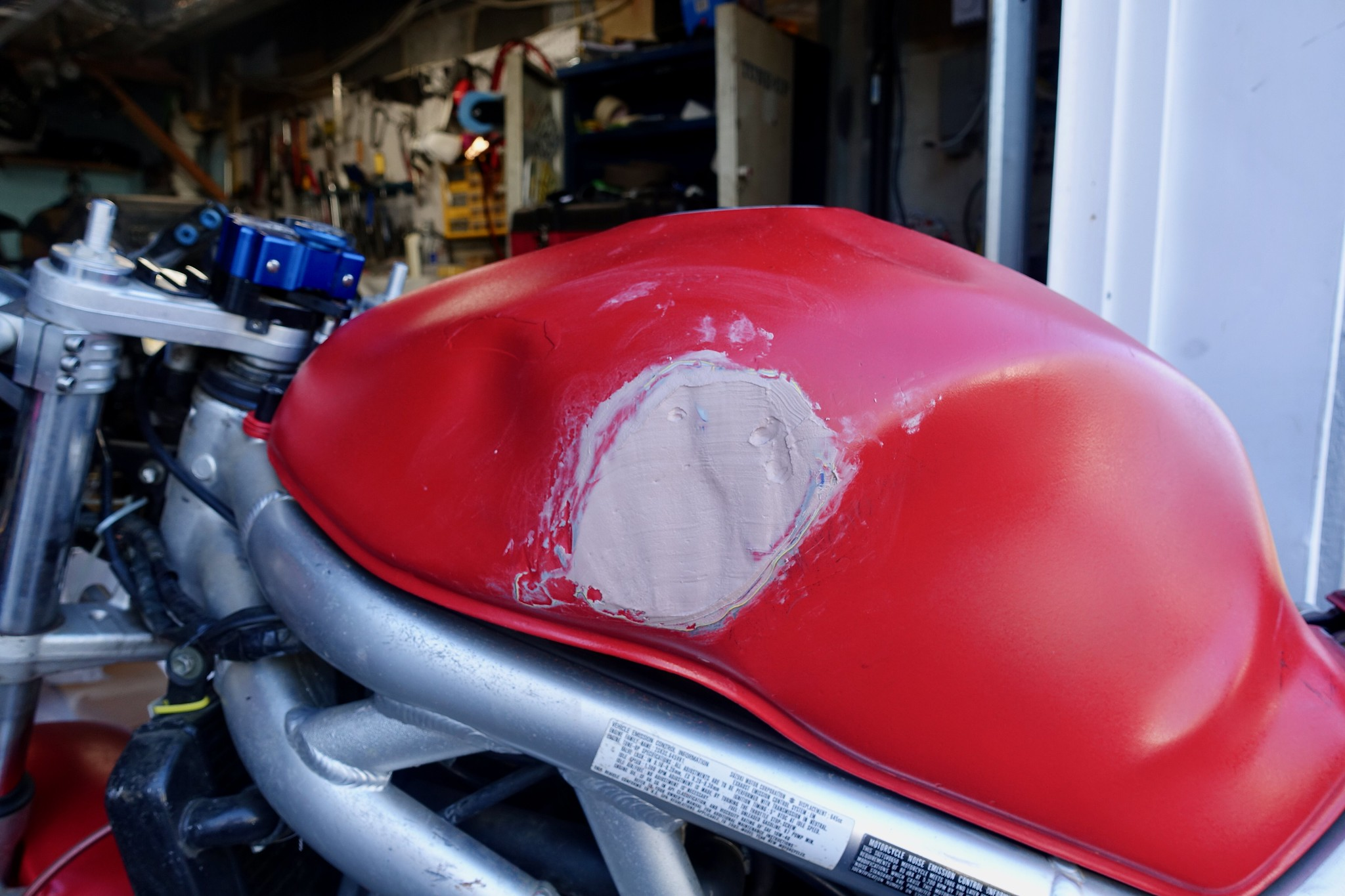 Bondo applied to a dented motorcycle tank