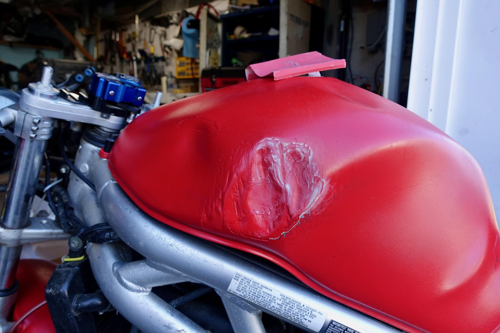 Dented motorcycle tank