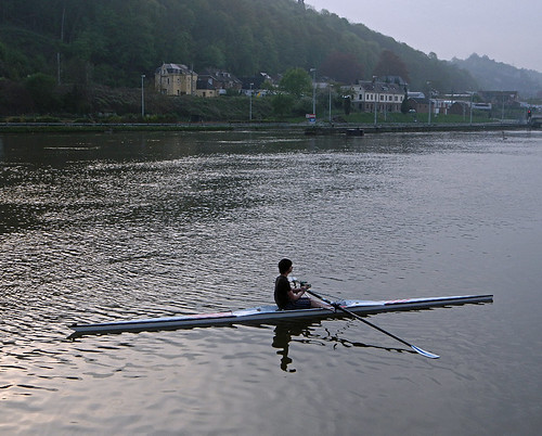 Sculling on the river Meuse in Dinant, Belgium